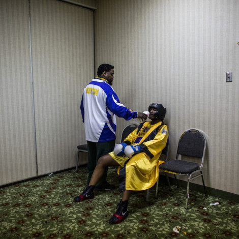 Coach Jason Crutchfield gives his fighter Claressa Shields a little water before she goes into the ring against former Canadian Champion Mary Spencer.