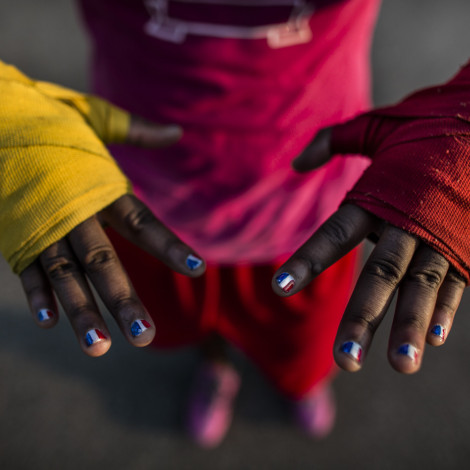 Claressa Shields has red, white and blue painted on her finger nails a month before she gets ready to go to the Olympic Games in London.