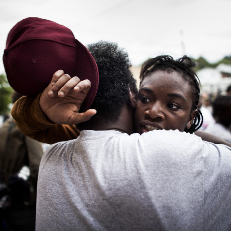 """The day she returned to Flint, Michigan from London after winning the Gold Medal in Womens Boxing, Claressa """"T-Rex"""" Shields hugs her father Clarence Shields outside the Berston Field House."""